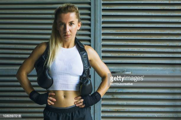 boxing her way to a ripper body - mixed martial arts stock pictures, royalty-free photos & images