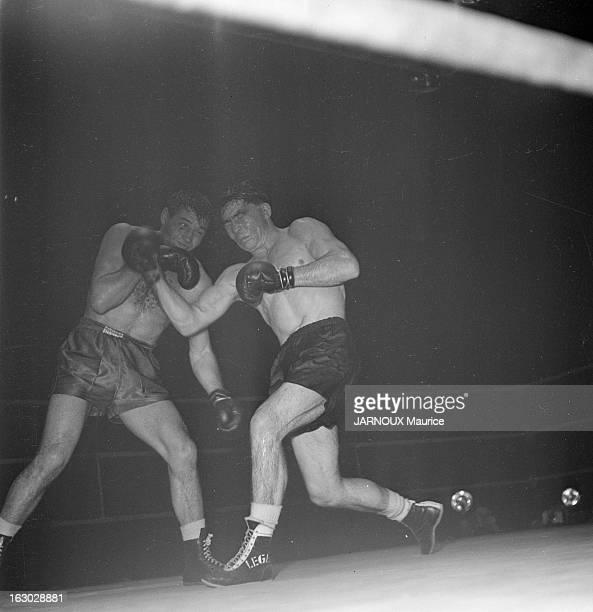 Tiberio Mitri Against Jean Stock Paris 21 décembre 1949 le boxeur italien Tiberio MITRI 23 ans champion d'Europe de boxe poids moyens remporte sa 46e...