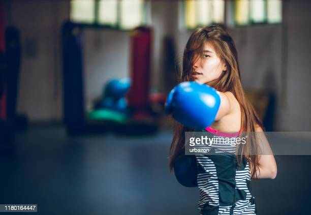 boxing in the gym - punching stock pictures, royalty-free photos & images