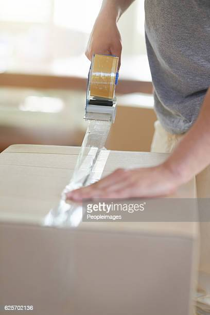 boxing it all up - tape dispenser stock photos and pictures