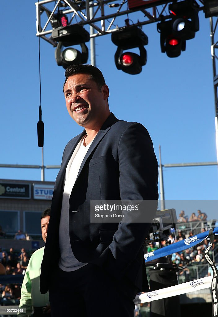 Boxing legend and promoter Oscar De La Hoya stands in the ring before Omar Figueroa Jr. met Daniel Estrada in their WBC Lightweight World Championship fight at StubHub Center on August 16, 2014 in Los Angeles, California.