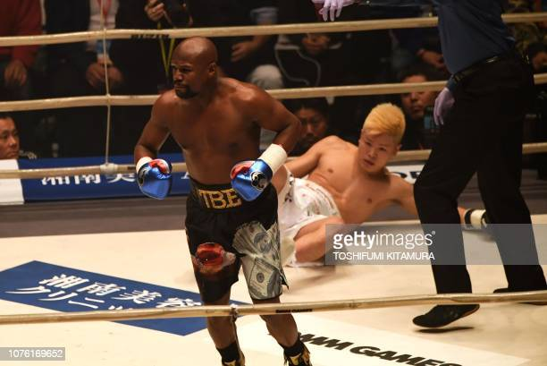 TOPSHOT US boxing legend Floyd Mayweather Jr knocks down Kickboxer Tenshin Nasukawa of Japan during their exhibition match at Saitama Super Arena in...
