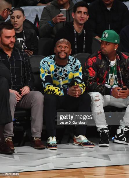 Boxing Legend Floyd Mayweather looks on during the USA Team against the World Team during the Mountain Dew Kickstart Rising Stars Game during AllStar...