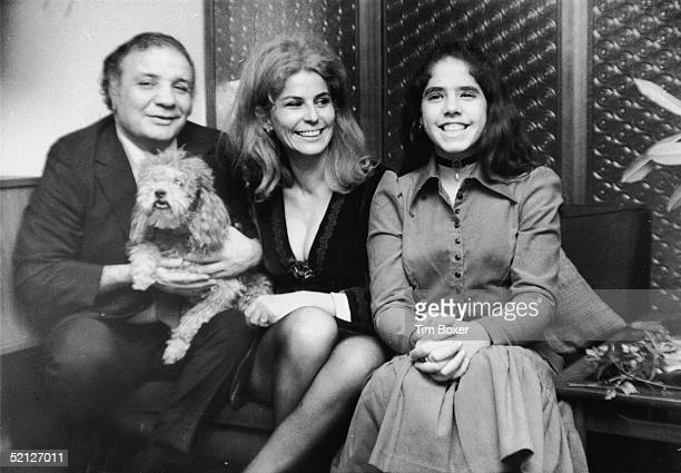 Boxing legend Jake LaMotta poses for a family portrait with his wife Dimitria his daughter Stephanie and their dog November 17 1970