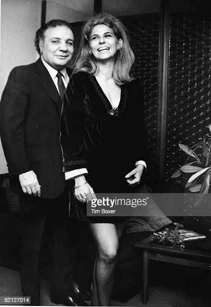 Boxing legend Jake LaMotta poses for a portrait with his wife Dimitria November 17 1970