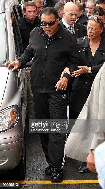 Boxing legend Muhammad Ali aided by his wife Lonnie arrives at Ricky Hatton's gym as part of his Uk charity tour on August 26 2009 in Manchester...