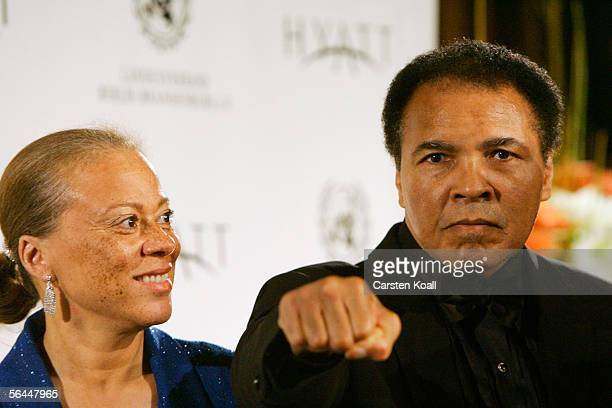 Boxing legend Muhammad Ali and his wife Lonnie Ali attend the award presentation of the Otto Hahn Peace Medal on December 17 2005 in Berlin Germany...