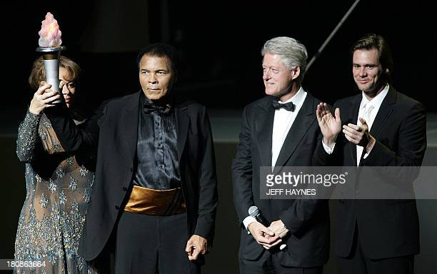 US boxing legend Muhammad Ali and wife Lonnie along with US President Bill Clinton and friend and actor Jim Carrey on stage 19 November 2005 during...