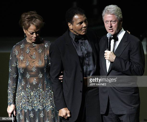 US boxing legend Muhammad Ali and wife Lonnie listen to former US President Bill Clinton on stage 19 November 2005 during the Grand Opening Gala for...