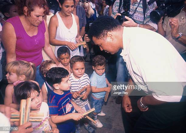 Boxing legend Muhammad Ali right visits with young children January 1996 at a hospital in Havana Cuba Ali was visiting the island to bring aid to...
