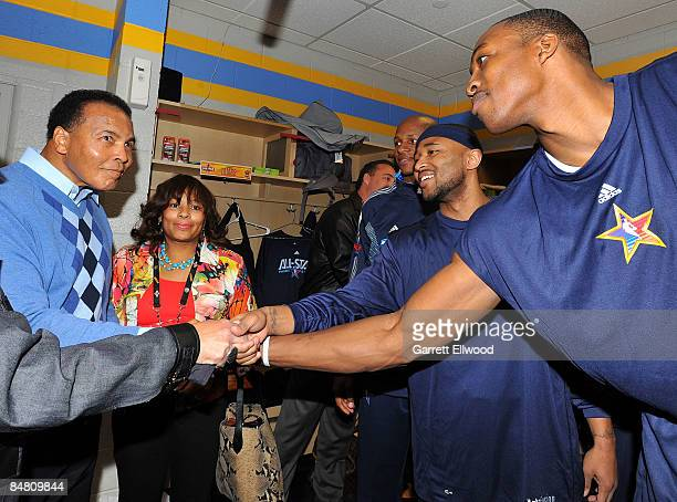 Boxing legend Muhammad Ali shakes hands with Dwight Howard of the Orlando Magic and Mo Williams of the Cleveland Cavaliers and before the 58th NBA...
