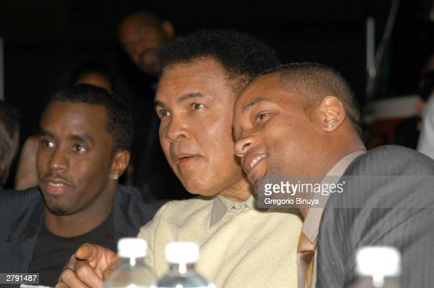 Boxing legend Muhammad Ali sits with actor Will Smith and singer Sean P Diddy Combs as they attend the Miami Art Basel Taschen book premiere of Ali's...