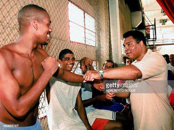US boxing legend Muhammad Ali spars with a Cuban amateur boxer 10 September during his visit to the Cerro Pelado sport complex in Havana Ali is on a...