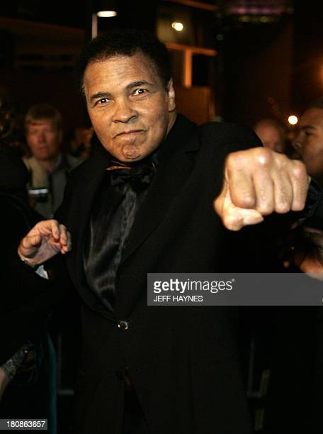 US boxing legend Muhammad Ali strikes a boxing pose on the red carpet entrance 19 November 2005 before the Grand Opening Gala for the Muhammad Ali...