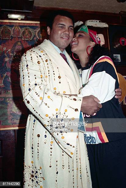 Boxing legend Muhammed Ali gets a kiss from his daughter May May after he donated the boxing robe he is wearing to the Hard Rock Cafe 5/12 The robe...