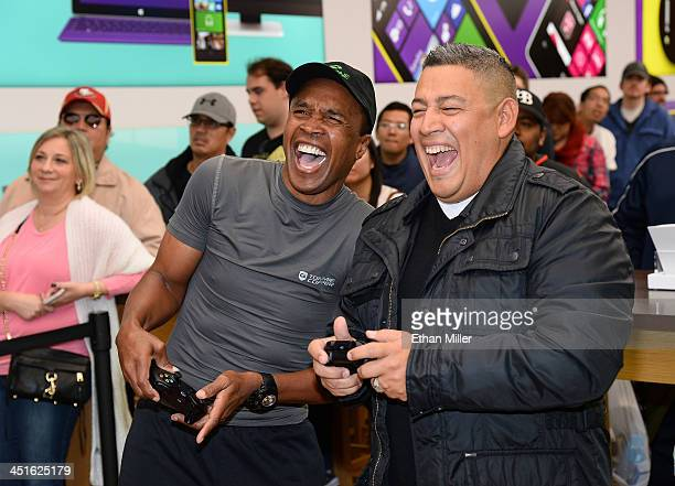 Boxing legend Sugar Ray Leonard and Luis Tobar of California play the Xbox One title 'Forza Motorsport 5' during an Xbox One Sports Star Challenge...