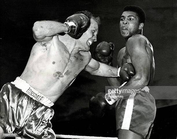 Boxing London England 18th June 1963 British heavweight fighter Henry Cooper lands a punch on America's Cassius Clay during their Heavyweight title...