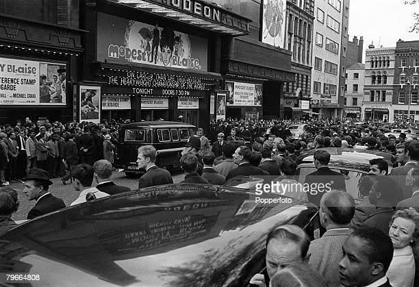 Boxing London England 21st May American World heavyweight champion Cassius Clay pictured leaving the Odeon Cinema in Leicester Square after weighing...