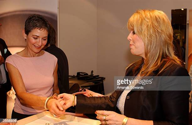 Boxing manager Jackie Kallen looks at jewelry with Carol Witlin at the Knockout Preview Party hosted by Jackie Kallen and Neissing Jewelry in the new...