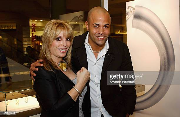 Boxing manager Jackie Kallen poses with boxer Tarick Salmaci at the Knockout Preview Party hosted by Jackie Kallen and Niessing Jewelry in the new...