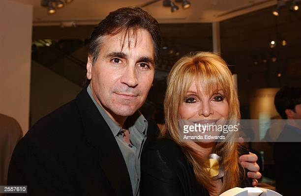 Boxing manager Jackie Kallen poses with her boyfriend Gary Baldassarre at the Knockout Preview Party hosted by Jackie Kallen and Niessing Jewelry in...