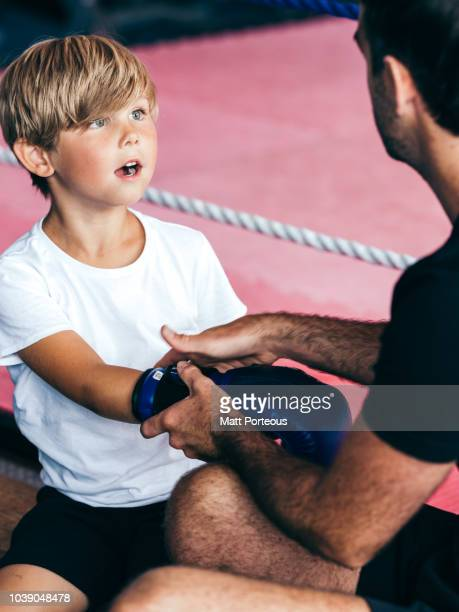 Boxing mentor coaches kid