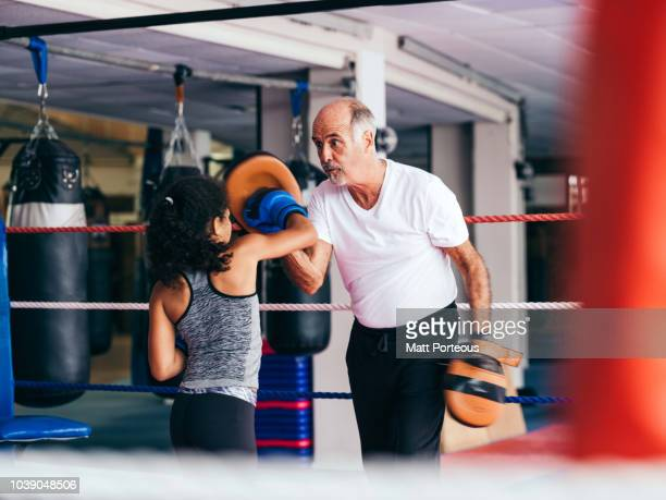 Boxing mentor spars with kid