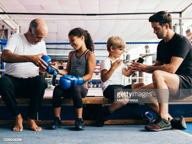 Boxing mentors teaching kids
