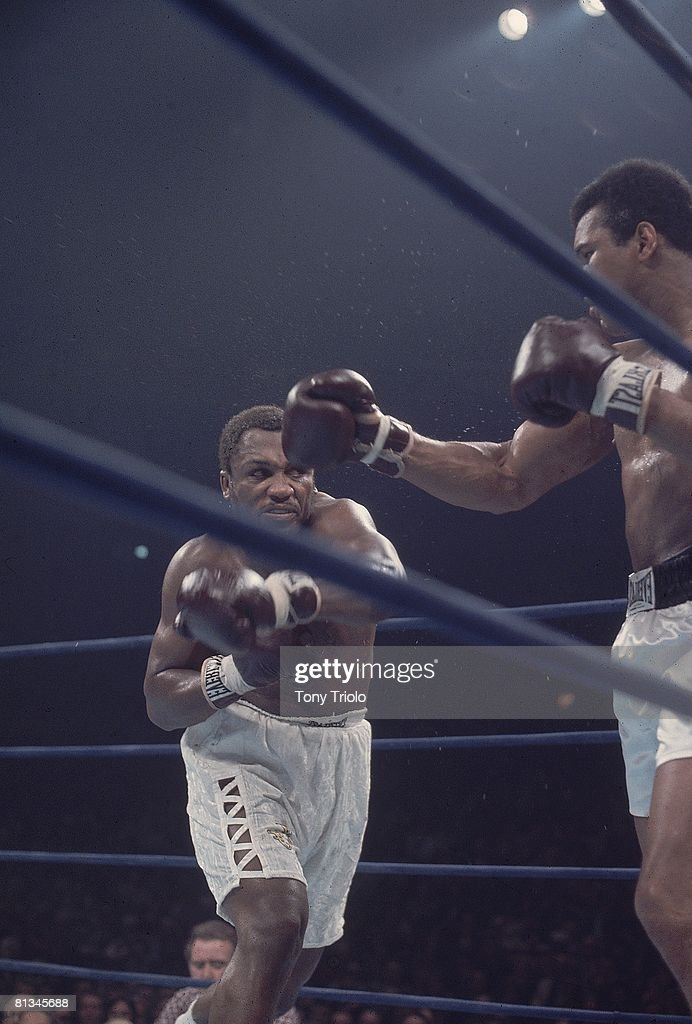 NABF Heavyweight Title, Joe Frazier (L) in action, throwing punch vs Muhammad Ali (R) at Madison Square Garden, New York, NY 1/28/1974