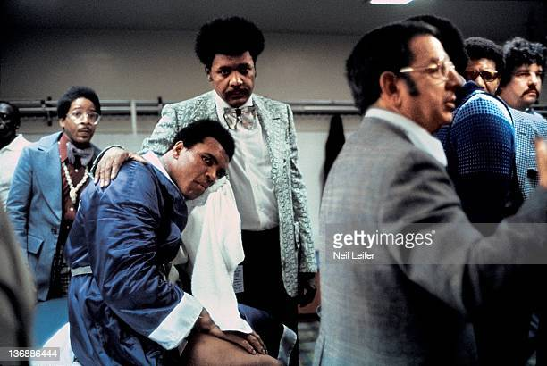 Boxing NABF Heavyweight Title Muhammad Ali icing down broken jaw injury with promoter Don King in dressing room after losing fight to Ken Norton at...