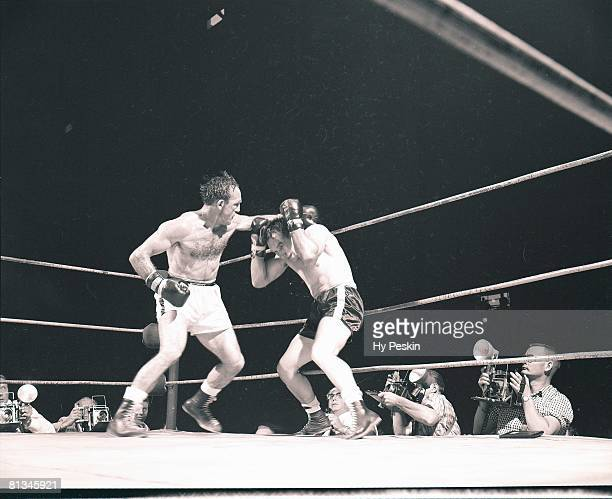 Boxing NBA World Middleweight Title Carmen Basilio in action throwing punch vs Gene Fullmer at Cow Palace San Francisco CA 8/28/1959