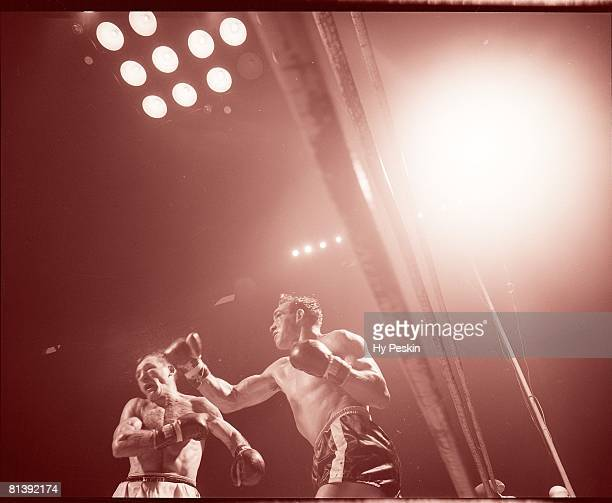 Boxing NBA World Middleweight Title Gene Fullmer in action throwing punch vs Carmen Basilio at Cow Palace San Francisco CA 8/28/1959