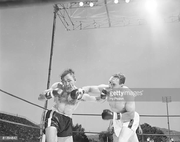 Boxing NBA World Middleweight Title Gene Fullmer in action throwing punch vs Carmen Basilio at Derks Field Salt Lake City UT 6/29/1960