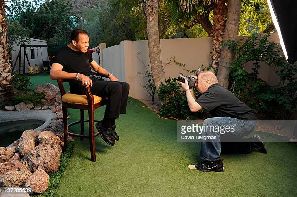 Portrait of former heavyweight champion Muhammad Ali posing while getting his picture taken by photographer Neil Leifer during photo shoot at his...