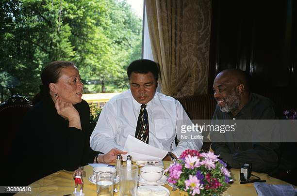 Boxing Portrait of former heavyweight champion Muhammad Ali with his wife Lonnie Ali and his friend photographer Howard Bingham during breakfast at...