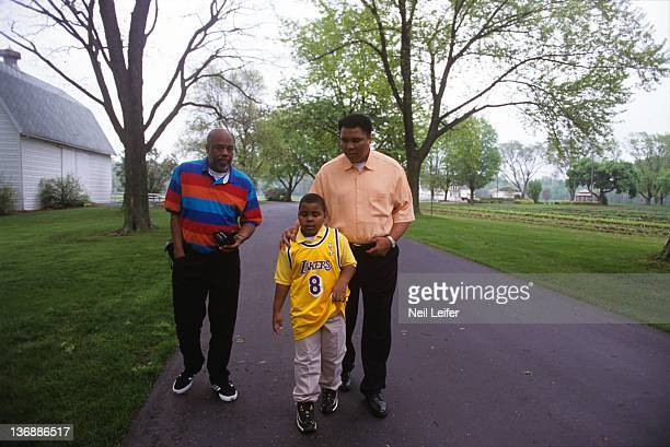 Boxing Portrait of former heavyweight champion Muhammad Ali with his son Assad Amin Ali and his friend photographer Howard Bingham during photo shoot...