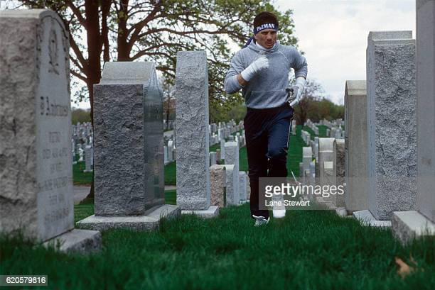 Portrait of Lightweight boxer Vinny Pazienza jogging in St Ann's Cemetery during training session photo shoot Pazienza is 221 for his career and is...