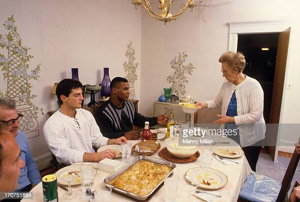 Portrait of Mike Tyson eating dinner with his surrogate mother, Camille Ewald , during photo shoot in her house. Catskill, NY 12/1/1985 CREDIT: Manny...