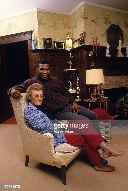 Portrait of Mike Tyson with his surrogate mother, Camille Ewald, during photo shoot in her house. Catskill, NY 12/1/1985 CREDIT: Manny Millan