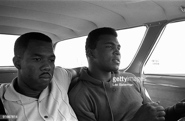 Portrait of Muhammad Ali sitting in car with friend photographer Howard Bingham Las Vegas NV 11/5/1965 CREDIT Lee Balterman