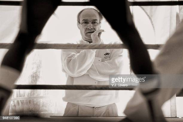 Portrait of Sports Illustrated senior writer William Nack looking on from outside of ring during Sugar Ray Leonard workout at Sheraton San Marcos...