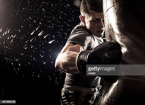 boxing power - punching stock pictures, royalty-free photos & images