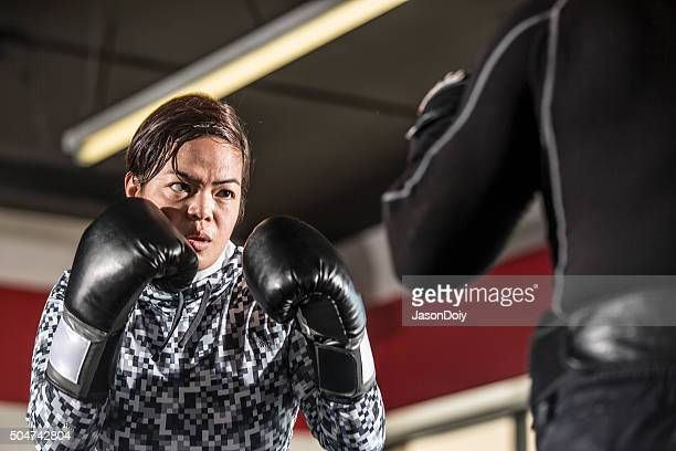 boxing: practice training with punch pads in a boxing ring - padding stock photos and pictures