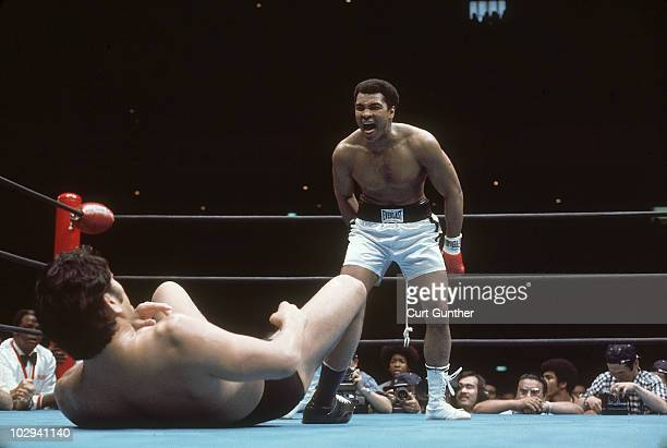 Heavyweight champion Muhammad Ali taunting Japan Kanji Antonio Inoki during exhibition match at Nippon Budokan Fight ended as draw Tokyo Japan...
