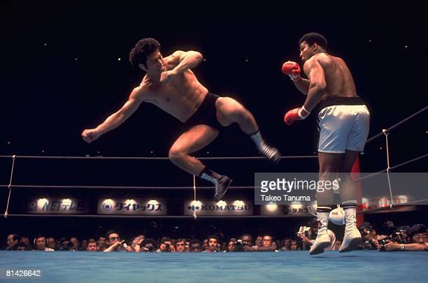 Boxing Professional Wrestling Japan Kanji Antonio Inoki in action vs heavyweight champion Muhammad Ali during exhibition match at Nippon Budokan...