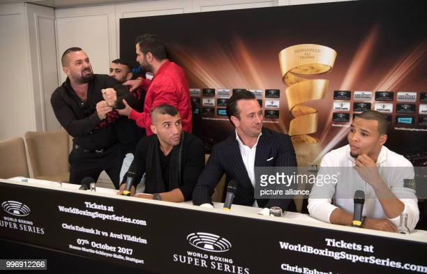 Boxing promoter Ahmet Oner gestures towards one of Eubank's staff and is held back by members of his team at a press conference ahead of the World...