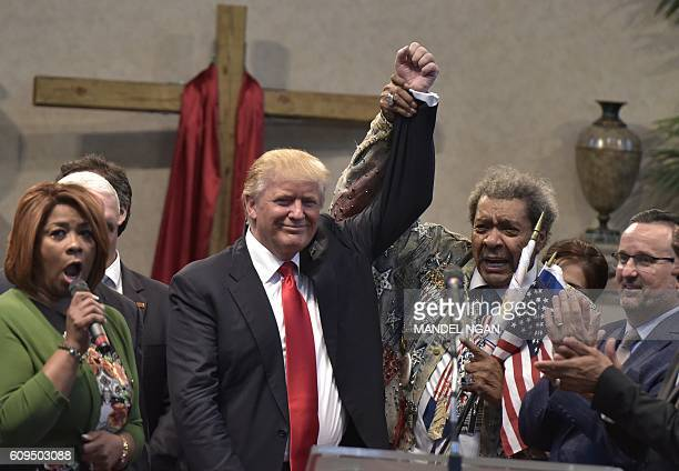 Boxing promoter Don King raises the arm of Republican presidential nominee Donald Trump during the Midwest Vision and Values Pastors and Leadership...