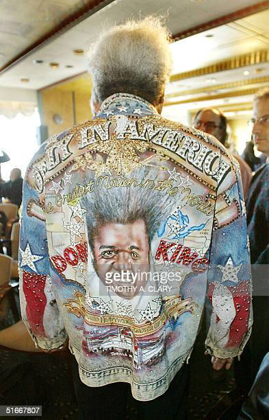 Boxing promoter Don King shows off his Only In America jean jacket before the start of a news conference to promote the upcoming World Heavyweight...