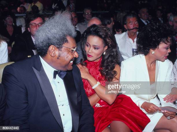 Boxing Promoter Don King with Actress Robin Givens and Robins mother ringside at Tyson vs Holmes Convention Hall in Atlantic City New Jersey January...