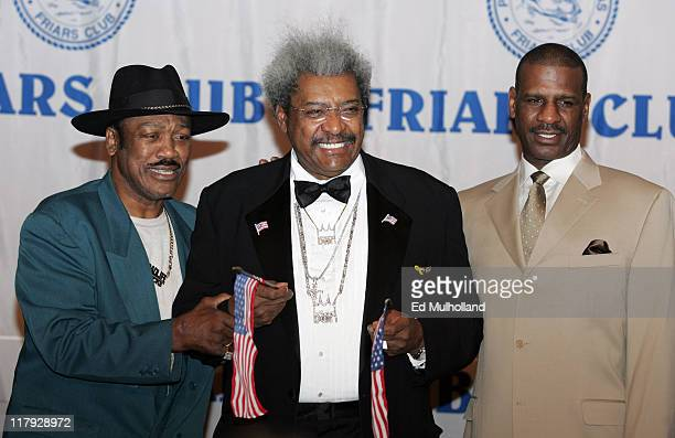 Boxing Promoter Don King with former heavyweight champions Joe Frazier and Michael Spinks prior to King's celebrity roast at the New York Hilton in...